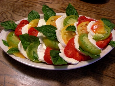 heirloom tomatoes and mozzarella, with lettuce leaf basil
