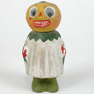 """ Composition ""Pumpkin Girl"" candy container painted in tones of yellow, green, blue, red, and white; marked ""Germany;"" circa 1910. Height=4.5 Price: $795.00"""