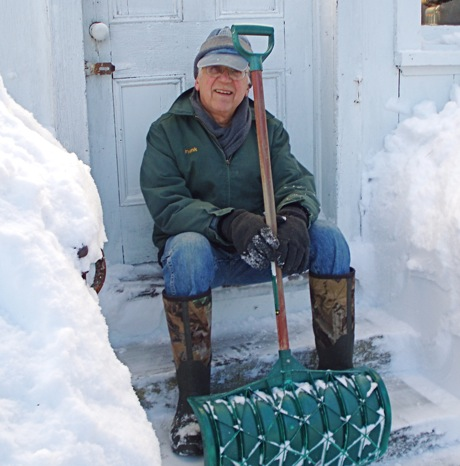 snow shoveler and his work