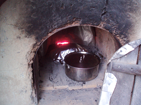 wood fired clay bake oven with stockpot and covered roast