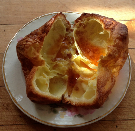 freshly baked popover, split and filled