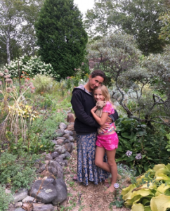 Celia and Ursula surrounded by perennial plantings in the Upper Garden